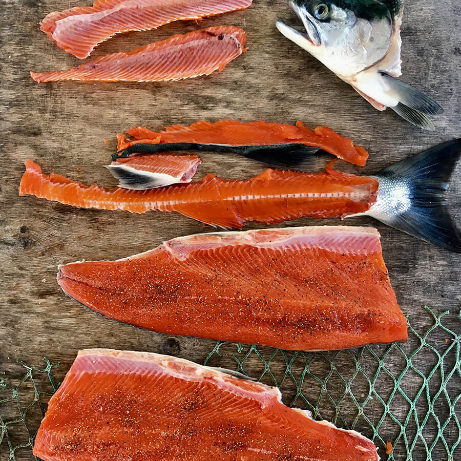 Wild Salmon filleted and broken down to prepare for cooking
