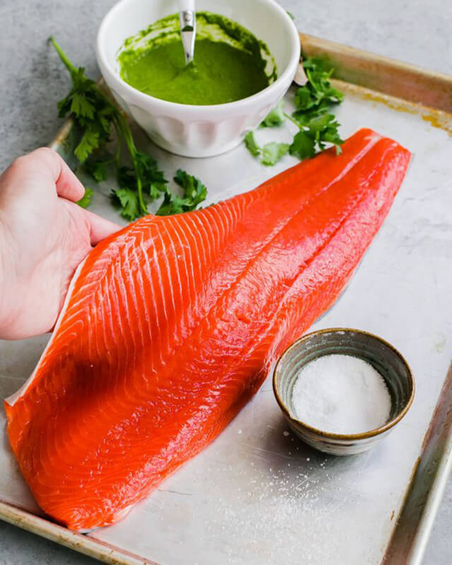 Salmon held up on counter for preparation